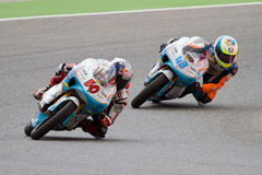 Moto riders. BARCELONA - JUNE 4: Sturla Fagerhaug (50) and Francesco Mauriello (43) of WTR Ten10 team racing at Qualifying Session of Moto 125 Grand Prix of royalty free stock photo