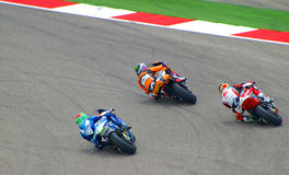 Moto2 motorcycle riders race in Austin, Texas USA. Moto2 riders Franco Morbidelli (number 21), Sam Lowes (number 22) and Azian Shah (number 25) race in the royalty free stock photo