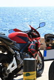 Moto and sea. Motorcycles parked at the curb of the road on a Sunny day by the sea Stock Photo