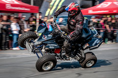 Moto stunt-riding quad bike Stock Photo