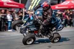 Moto stunt-riding quad bike Stock Photo