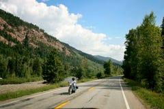 Moto sur la route de montagne Image libre de droits