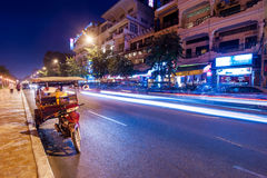 Moto taxi at evening asian city. Phnom Penh, Cambodia Royalty Free Stock Photo