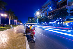 Moto taxi at evening asian city. Phnom Penh, Cambodia Royalty Free Stock Image