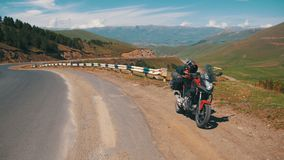 Moto travel. Tourist Motorcycle Stands Along a Serpentine Road in the Mountains of Armenia. stock video