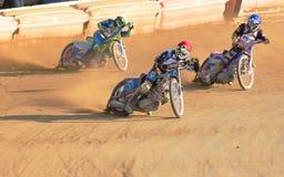 Moto trio cornering Stock Image