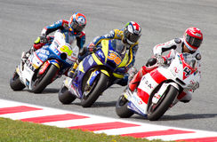 Moto2 Grand Prix. BARCELONA - JUNE 5: Esteve Rabat (34), Bradley Smith (38) and Randy Krummenacher (4) racing at the race of Moto2 Grand Prix of Catalunya, on Royalty Free Stock Photography
