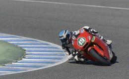 Moto2 test at Jerez racetrack - Day 2. JEREZ DE LA FRONTERA, SPAIN, FEBRUARY 19, 2014: The Spanish pilot Axel Pons during training Moto2 2014 on the racetrack Stock Image