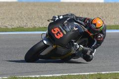 Moto2 test at Jerez racetrack - Day 2. JEREZ DE LA FRONTERA, SPAIN, FEBRUARY 19, 2014: The Spanish pilot Esteve Rabat during training Moto2 2014 on the Royalty Free Stock Photo