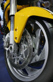Motobike. Front wheel of yellow bike Stock Photo