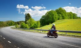 Motobike on asphalt road in beautiful summer evening Royalty Free Stock Photography