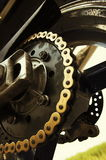 Motobike chain. Detail of back wheel - Suzuki motobike Royalty Free Stock Photography