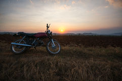 The motobike on the field, sunset in country and beatyful cloud on sky Dalat city - in LamDong- VietNam. The motobike on the field, sunset in country and Stock Photography