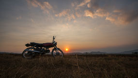 The motobike on the field, sunset in country and beatyful cloud on sky Dalat city - in LamDong- VietNam. The motobike on the field, sunset in country and Stock Photos