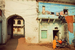 Motobike stands in old courtyard of the ancient indian house Stock Photo