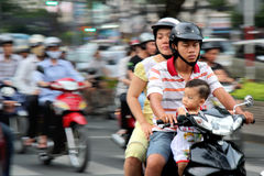 Motobikes in Vietnam. Family riding on a motorbike in Ho Chi Minh, Vietnam Royalty Free Stock Image