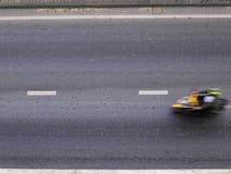 Motocicleta de la falta de definición en el camino Imagen de archivo libre de regalías