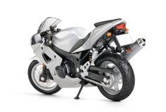 Motocicleta del juguete en el fondo blanco Foto de archivo libre de regalías