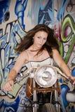 Motocicleta del montar a caballo de la muchacha Foto de archivo libre de regalías