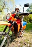 Motocicleta del montar a caballo del bebé Fotografía de archivo libre de regalías