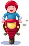 Motocicleta del montar a caballo del muchacho Imagen de archivo