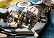 Motocicleta que compite con guantes Imágenes de archivo libres de regalías