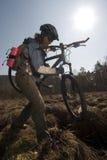 Motociclista da mulher no swampland Foto de Stock Royalty Free