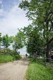 Motociclista em uma estrada do campo Imagens de Stock Royalty Free