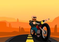 Motociclista no deserto Imagens de Stock