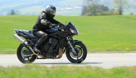 Motociclista preto Imagem de Stock Royalty Free