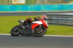 Motociclista rápido Imagens de Stock