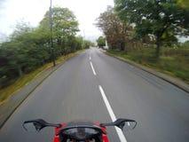 Motociclo sulla strada Fotografia Stock