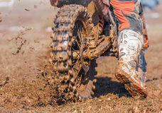 Motocross boots and wheel. On mud, to start stock photos