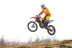 Motocross racer jumping. On a hill royalty free stock photography