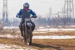 Motocross racer. With mud on motorbike Stock Photography
