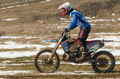 Motocross racer. On mud and snow royalty free stock image
