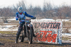 Motocross racer. Motocros racer on mud and snow preparing to start royalty free stock photos