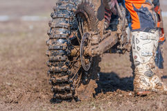 Motocross wheel and boots. Ready to start royalty free stock photo
