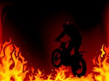 Motocross. Silhouette of motobiker in the flames Royalty Free Stock Photos
