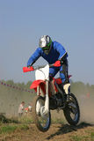Motocross. Man on motorcycle takes part in motocross sport competition stock image