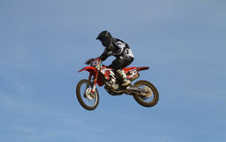 Motocross. An anonymous motocross rider in a big jump. Picture taken during practice at a danish motocross club. Motocross is a form of motorcycle racing held on royalty free stock image