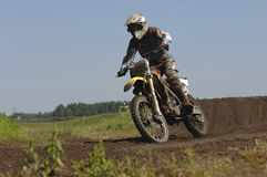Motocross. Racer shoot from down position royalty free stock photo