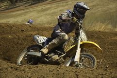 Motocross. Rider accelarating out of a corner stock photography