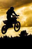 Motocross. Rider in a dirt track race Stock Photos
