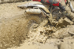 Motocross accelerating speed in mud. Track Stock Image