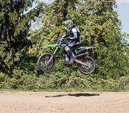 Motocross action. Racer in action on Motocross track in Germany. Picture taken during practice on May 07th 2016 Stock Image