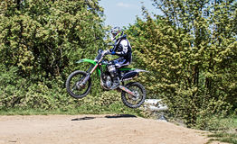 Motocross action. Racer in action on Motocross track in Germany. Picture taken during practice on May 07th 2016 Royalty Free Stock Image
