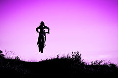 motocross action with sunset background Royalty Free Stock Photo