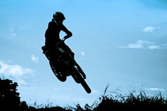 motocross action with sunset background Royalty Free Stock Photos