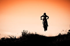 Motocross Action With Sunset Background Stock Photos